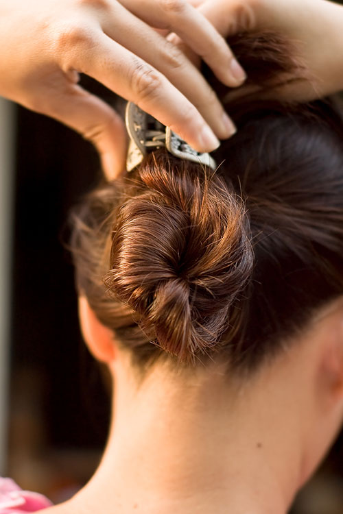 Woman with claw-clip bun hairstyle trend